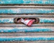Mail shoved into a door slot - Photo by Franck V. on Unsplash
