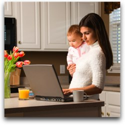 Woman with child checking email